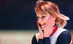 Elise Christie celebrates after winning triple gold at the short track speed skating world championships in Rotterdam
