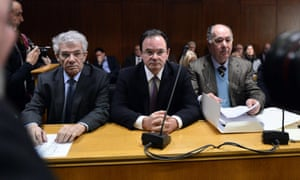 Former finance minister George Papaconstantinou (C) sits between his lawyers, as he appears before a special court in Athens on February 25, 2015, to face charges for allegedly tampering with a confidential tax document known as the 'Lagarde list'. AFP PHOTO/ Louisa GouliamakiLOUISA GOULIAMAKI/AFP/Getty Images