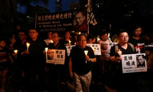 Protesters in Hong Kong carrying candles in a march to mourn the death of Nobel Peace laureate Liu Xiaobo.