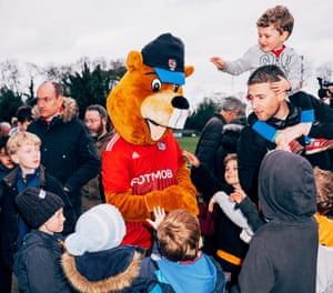 Joel Golby as mascot Bertie the Beaver greets young fans at a football match