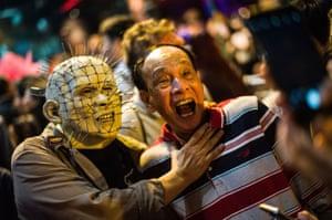 People take part in a Halloween street party at Lan Kwai Fong in Hong Kong