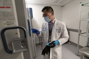 Pharmacist Billy Sin by a refrigerator that will store Covid-19 vaccines at Mount Sinai Queens hospital in New York. Pfizer's vaccine presents challenges because it must be stored at -94F (-70C).