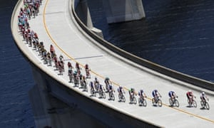 Riders in a peloton can reduce drag, and so save energy, by riding in the wake of a leading rider, slipstreaming them. Here, the peloton rides across Twitchell Reservoir during the AMGEN Tour of California.