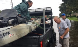 Brad and Wayne Johns load up after a failed attempt to evacuate Houston residents.