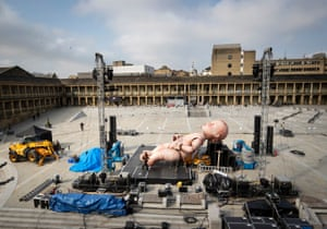 A giant mechanical baby is installed ahead of Mind the Gap theatre company's first performance of Zara at the the Piece Hall in Halifax. It is billed as a unique theatrical experience including a cast of more than 100 and 3D projection mapping