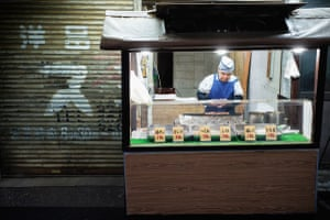 With the original shop in Komagome closed down and emptied out, this man now sells yakitori outside