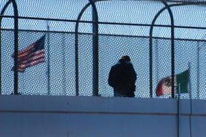A man crosses the footbridge to Juarez, Mexico, from El Paso, Texas