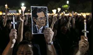 Tens of thousands of mourners in Bangkok pay tribute to Thailand's King Bhumibol Adulyadej.