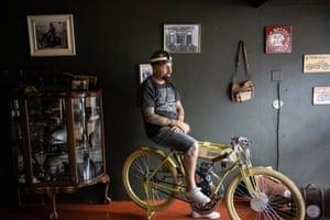 Johannesburg, South Africa: Desmond Soekoe, founder of Soekoe Moto-Bicycle Company, prepares to ride one of his motorised bikes, based on early 20th-century designs