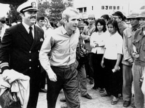 On 14 March 1973, McCain is escorted to Hanoi's Gia Lam Airport, after being released from captivity.