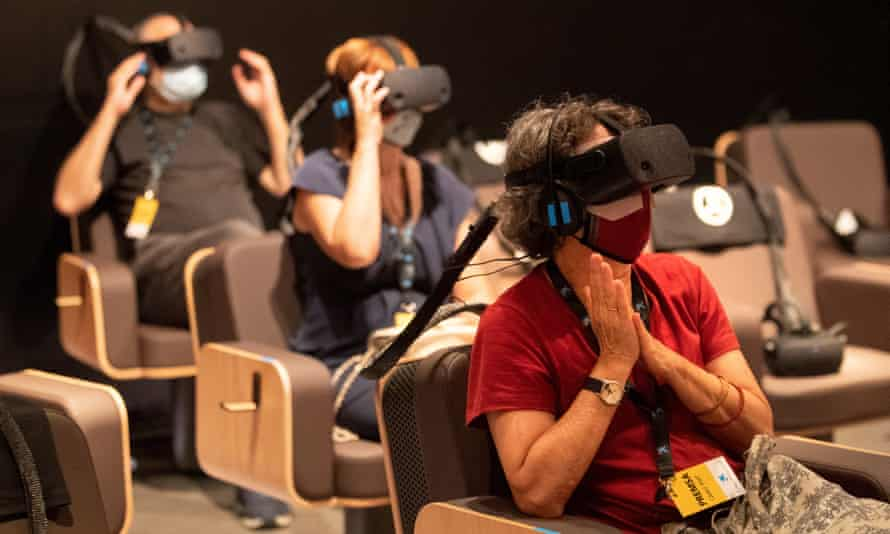 People experience the virtual reality of Symphony.