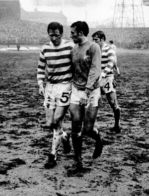 Celtic's Billy McNeill pictured with Rangers' Ron McKinnon as they walk of walk off a muddy Hampden Park after Celtic beat their Glasgow neighbours in 3-1 in the quarter-final of the Scottish Cup quarter-final. Celtic made it to the final but lost to Aberdeen