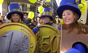Women dressed as euro coins in central Dublin on 31 December 2001, the day before the euro became legal tender.