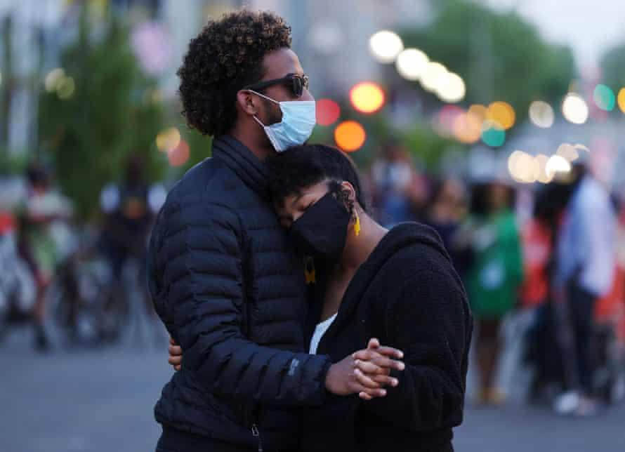 Xochitl Ramirez and Angel Reyes from Panama embrace following the verdict, in Washington DC.