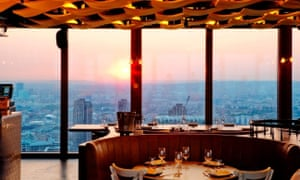 Sunset, as seen, from the windows of the 24 hours a day restaurant Duck & Waffle, in the City district of London.