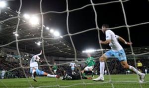 Northern Ireland's Gavin Whyte scores their third goal.