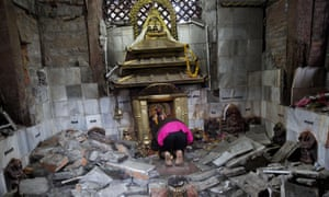 A Hindu Nepalese woman in Kathmandu, Nepal, offers prayers in the ruins of Indrayani temple