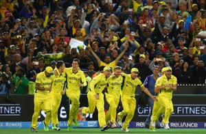 The Australian players and crowd celebrate victory.