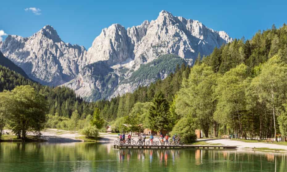 Group of mountainbikers at Jasna Lake, Slovenia.