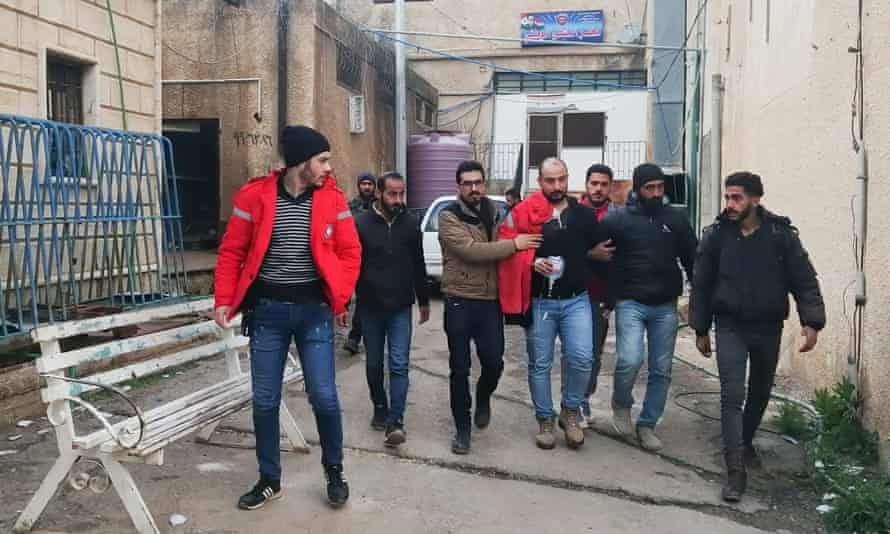 A Syrian Oxfam aid volunteer, who was wounded the previous day in an attack, leaves hospital in al-Yadudah.