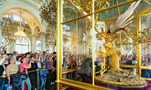 Tsars in their eyes … tourists flock around the Peacock Clock in the Hermitage Museum.