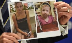 A NSW policeman holds up a photo of Karlie Jade Pearce-Stevenson and Khandalyce Pearce.
