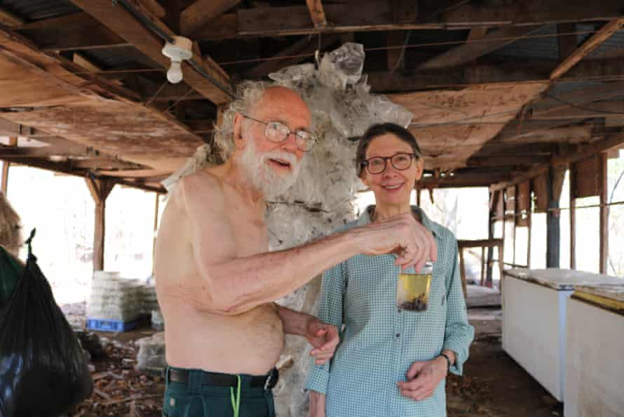Daniel Janzen and Winnie Hallwachs in an outhouse filled with samples near their cabin in the ACG. Janzen is holding a jar of frozen insects that will be DNA barcoded in Canada.