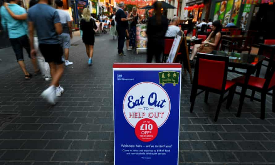 People dining outside in London's Chinatown last August.