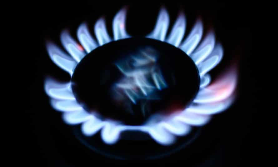 A gas flame is seen on a domestic cooker