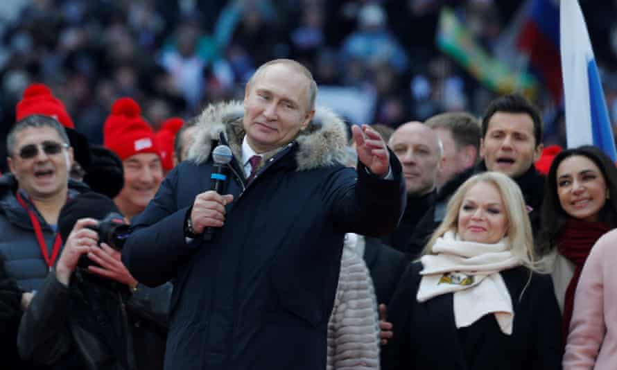 Vladimir Putin addresses a rally at the Luzhniki Stadium