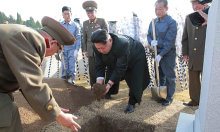 Kim Jong-un drops earth in the grave of Ra Uh-sol, a former marshal of the Korean People's Army (KPA) in Pyongyang this week.