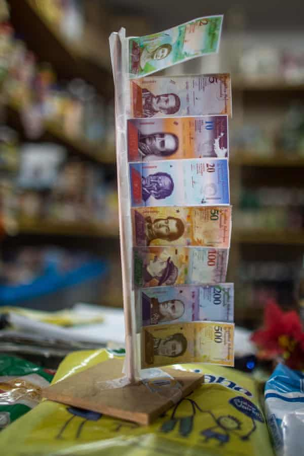 Bill samples of the new 'sovereign bolívar' currency in a store in Caracas.