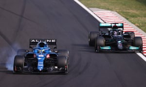 Fernando Alonso of Spain driving the (14) Alpine A521 Renault locks a wheel under braking as he defends from Lewis Hamilton of Great Britain driving the (44) Mercedes AMG Petronas.