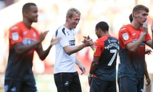 Swansea City manager Graham Potter celebrates with Jefferson Montero at the end of the match.