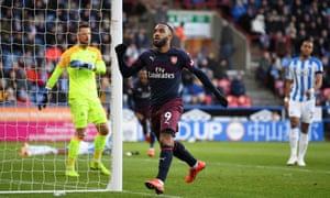 Alexandre Lacazette celebrates after scoring Arsenal's second goal against Huddersfield.