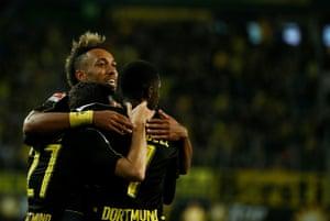Dortmund's Pierre-Emerick Aubameyang, centre, celebrates with team-mates Ousmane Dembélé, right, and Gonzalo Castro.