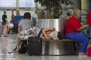 British passengers await news of canceled Thomas Cook flights at Palma de Mallorca airport yesterday