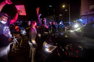 Protesters blocked a police car in downtown Los Angeles.