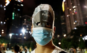 Anti-government protesters wearing costumes march during Halloween in Hong Kong