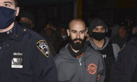 Danny Presti is taken away in handcuffs after being arrested on Tuesday.