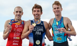 Pierre Le Corre, centre, with his gold medal after beating Fernando Alarm of Spain into second Marten Van Riel of Belgium into third.