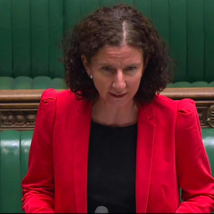 Anneliese Dodds wears a puff-shouldered red jacket