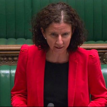 Anneliese Dodds wears red puff-shoulder jacket