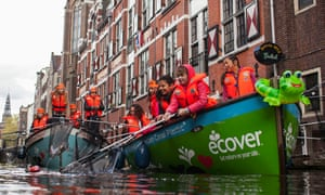 Children take a trip to clean the waterways on a boat trip with Plastic Whale in Amsterdam.