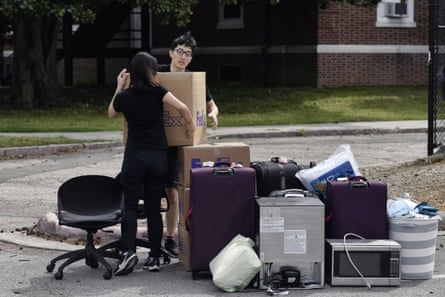 Freshmen Duke Feng Cong from Singapore and Cassie Lu from Thailand move out of their dormitory at Duke University on March 15.