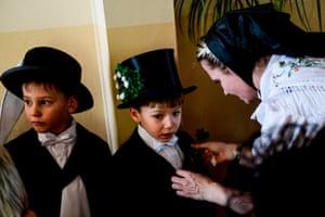 A Sorbian woman dresses a child