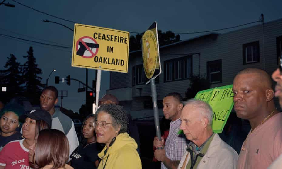 Oakland residents look at a memorial for victims of gun violence during a peace walk against violence on 14 June 2019.