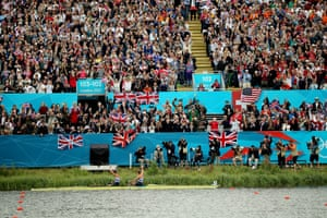 Rowers Helen Glover and Heather Stanning wave to spectators after their win in the coxless pairs brought Team GB its first gold medal of the Olympics.