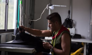 A former Farc guerilla at work on a sewing machine