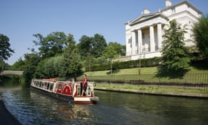 A boat glides along Regent's Canal in London